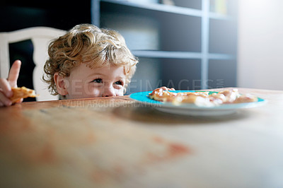 Buy stock photo Shot of an adorable little boy eating at home