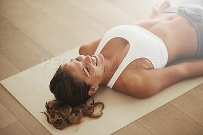 Buy stock photo Shot of an attractive young woman doing yoga