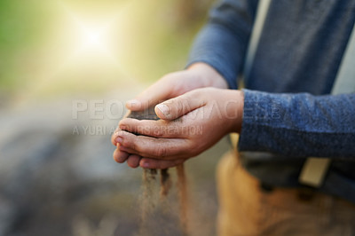 Buy stock photo Closeup shot of a little boy holding soil in his hands