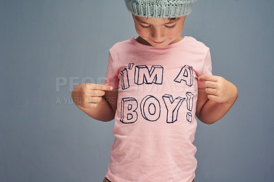 "Buy stock photo Studio shot of a boy wearing a t shirt with ""I'm a boy"" printed on it against a gray background"