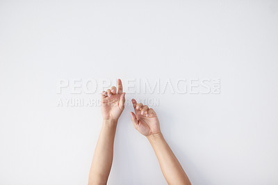 Buy stock photo Cropped shot of a unrecognizable person's  hands against a grey background stretching up