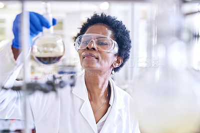 Buy stock photo Shot of a female scientist working in a lab