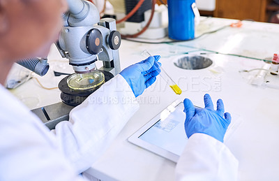 Buy stock photo Shot of a female scientist working on a digital tablet in a lab
