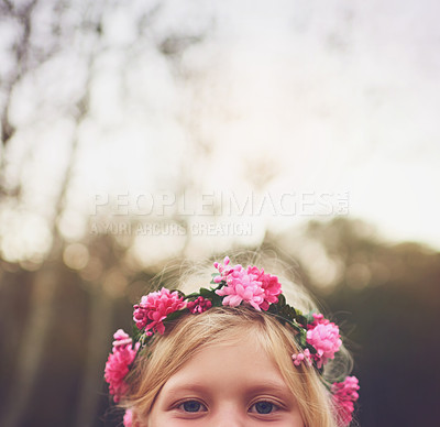 Buy stock photo Shot of a little girl's eyes looking at the camera and hiding while standing outside in nature