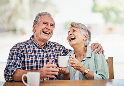 Buy stock photo Shot of a senior couple having coffee together at home