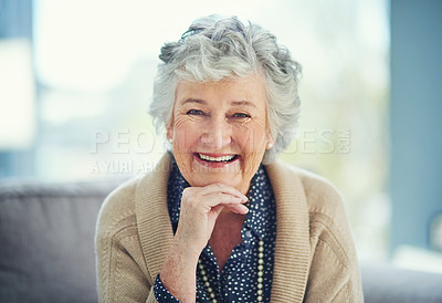 Buy stock photo Portrait of a happy senior woman relaxing on the sofa at home