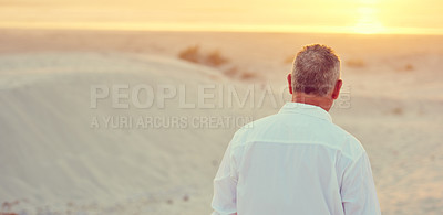 Buy stock photo Rearview shot of mature man walking on the beach at sunset
