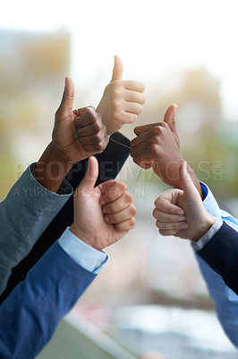 Buy stock photo Shot of a group of unrecognizable coworkers high fiving outside the office