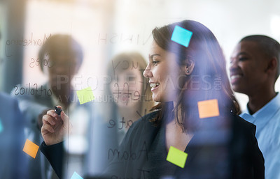 Buy stock photo Shot of a group of coworkers at the office