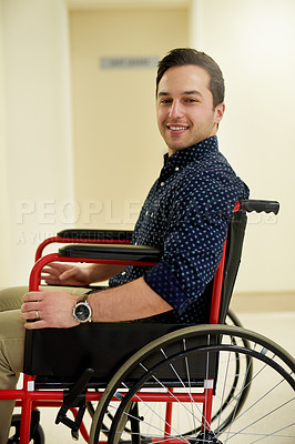 Buy stock photo Portrait of a young man sitting in a wheelchair in a hospital