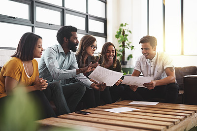 Buy stock photo Cropped shot of a group of young designers having a meeting in a modern office