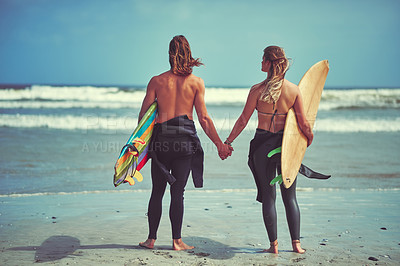 Buy stock photo Rearview shot of a young couple waiting for the perfect wave