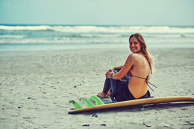 Buy stock photo Portrait of a beautiful young woman going for a surf at the beach