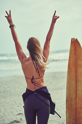 Buy stock photo Shot of a beautiful young woman going for a surf at the beach
