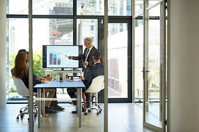 Buy stock photo Shot of a corporate businessperson giving a presentation in the boardroom