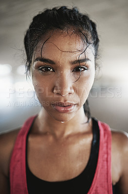 Buy stock photo Shot of a young woman getting fit outside