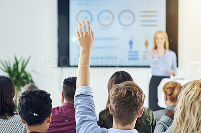 Buy stock photo Shot of a group of businesspeople raising their hands in a class