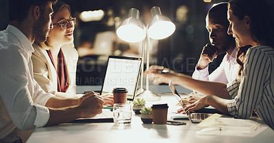 Buy stock photo Cropped shot of a group of businesspeople working around a table in the office