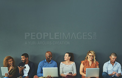 Buy stock photo Studio shot of a group of diverse people social networking against a gray background