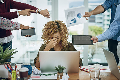 Buy stock photo Shot of a young businesswoman looking stressed out in a demanding office environment