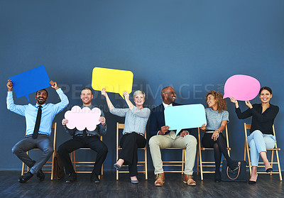 Buy stock photo Shot of a group of people holding up speech bubbles against a blue background
