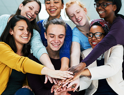 Buy stock photo Low angle shot of a group of coworkers stacking their hands on top of each other