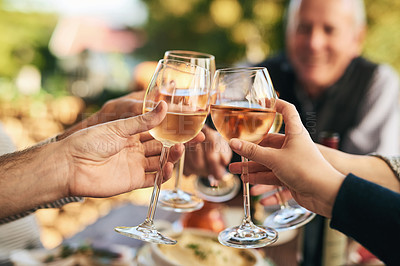 Buy stock photo Shot of a group unrecognizable people celebrating with a toast over a dinner table outside