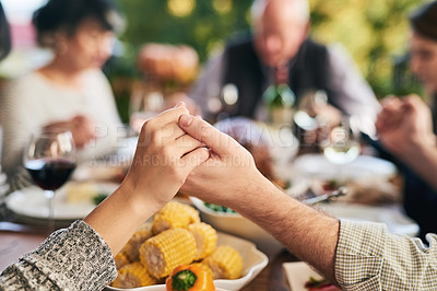 Buy stock photo Shot of two unrecognizable people holding hands at a dinner table