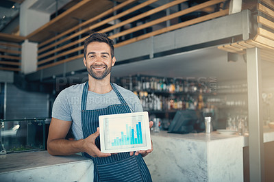 Buy stock photo Portrait of a young man holding a digital tablet with a graph on the screen at a coffee shop