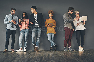 Buy stock photo Studio shot of a diverse group of creative employees social networking inside
