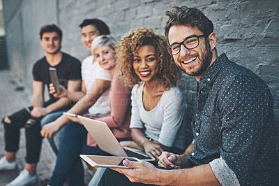 Buy stock photo Shot of a diverse group of people social networking outside
