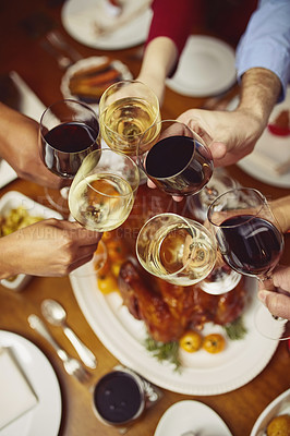 Buy stock photo Closeup shot of a group of people making a toast at a dining table