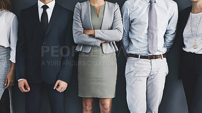 Buy stock photo Cropped studio shot of a group of businesspeople standing in line against a gray background