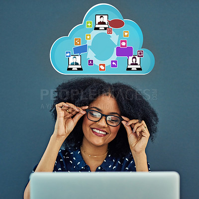 Buy stock photo Studio shot of a young woman using a laptop with a cloud illustration above her against a gray background