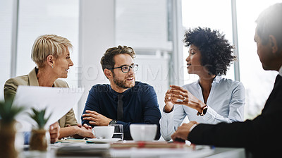 Buy stock photo Shot of a group of businesspeople sitting together in a meeting