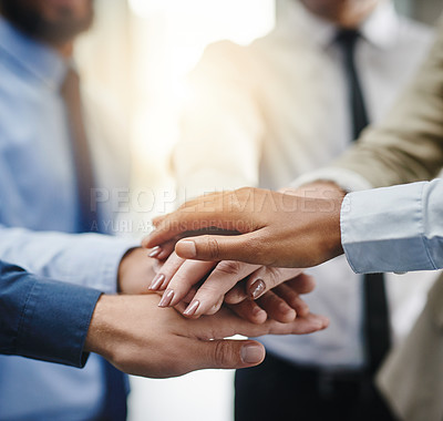 Buy stock photo Cropped shot of a group of businesspeople putting their hands together in unity
