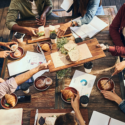 Buy stock photo High angle shot of a group of creative workers out on a business lunch