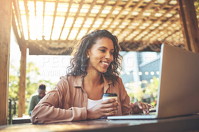 Buy stock photo Cropped shot of a young woman using a laptop in a coffee shop