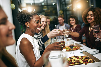 Buy stock photo Cropped shot of a group of young friends having a dinner party at a restaurant