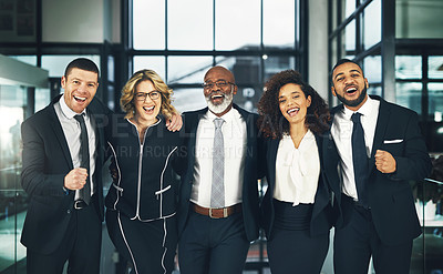 Buy stock photo Portrait of a team of happy business executives standing together in a modern office
