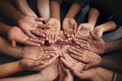 Buy stock photo High angle shot of a group of unrecognizable people's hands out with their palms open
