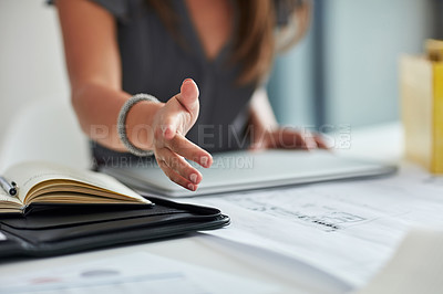 Buy stock photo Cropped shot of a businesswoman extending a handshake