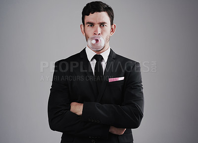Buy stock photo Studio shot of a well-dressed man posing against a gray background