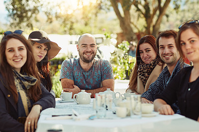 Buy stock photo Shot of a group of friends having lunch together