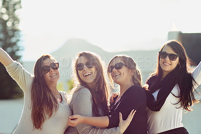 Buy stock photo Cropped shot of a group of friends enjoying themselves outdoors