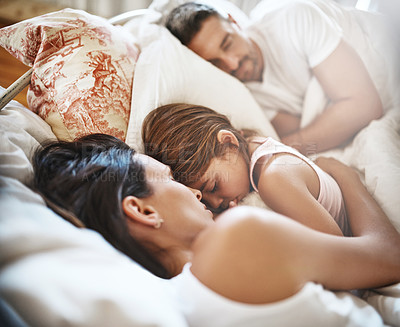 Buy stock photo Shot of a family sleeping in bed at home