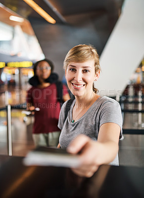 Buy stock photo Cropped portrait of an attractive young woman handing over her passport at a boarding gate in an airport