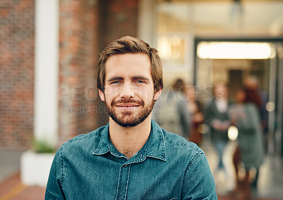 Buy stock photo Portrait of a confident young man standing outdoors on campus