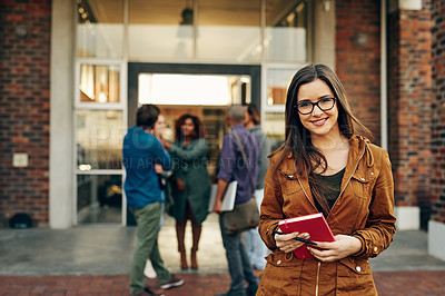 Buy stock photo Portrait of a happy young woman holding a notebook outdoors on campus