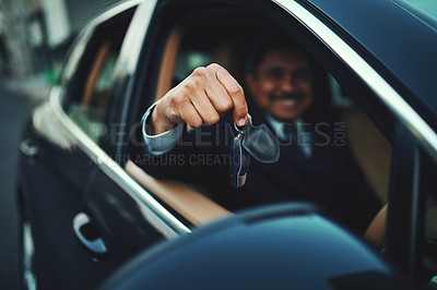 Buy stock photo Shot of a businessman holding the keys to a luxury car